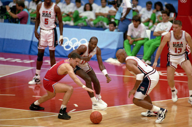 "BARCELONA, SPAIN - AUGUST 8: Drazen Petrovic #4 of Croatia goes after the ball against Charles Barkley and Clyde Drexler of the United States in the 1992 Olympic game on August 8, 1992 in Barcelona, Spain. The ""Dream Team"" defeated Croatia 117-85. NOTE TO USER: User expressly acknowledges and agress that, by downloading and or using this photograph, User is consenting to the terms and conditions of the Getty Images License Agreement. (Photo by Shaun Botterill/Getty Images)"
