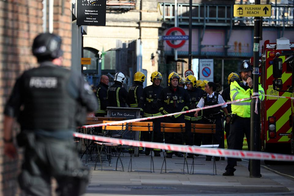 <p>Armed police join regular officers at the scene of the blast as fire crews also deal with the aftermath. (Reuters) </p>