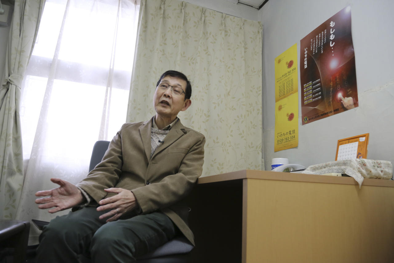 "In this March 15, 2017 photo, Shinjiro Shishido, director of ""Inochinodenwa"", non-profit telephone hotline for people seek help, speaks during an interview, in Tokyo. Fewer Japanese are taking their own lives, a glimmer of hope in a country with one of the world's highest suicide rates. The number of suicides has dropped for seven straight years in a clear indication of a downward trend. The Health Ministry said Thursday, March 23, 2017, that 21,897 people committed suicide in 2016, down from more than 30,000 in 2011. (AP Photo/Koji Sasahara)"