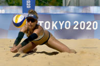 April Ross, from the United States, returns a volley during women's beach volleyball practice at the 2020 Summer Olympics, Monday, July 19, 2021, in Tokyo. (AP Photo/Charlie Riedel)
