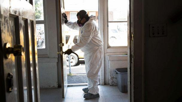PHOTO: A cleaning technician wearing PPE deep cleans the home of a family on May 14, 2020 in Stamford, Connecticut. (John Moore/Getty Images)