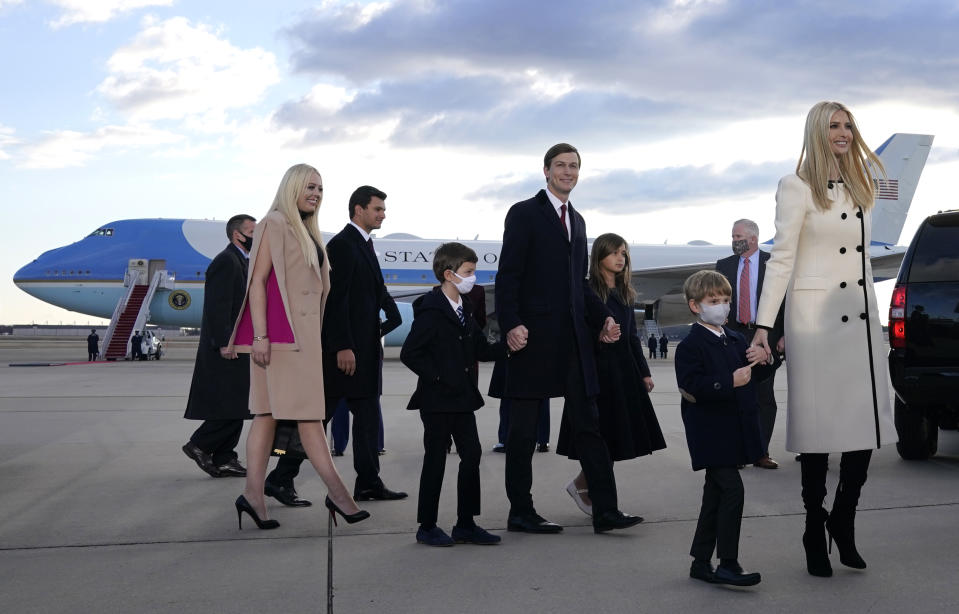 Ivanka Trump (R), husband Jared Kushner (C), their children, Eric (R) and Donald Jr. (2nd R), Tiffany Trump (L) and Trump family members stand on the tarmac at Joint Base Andrews in Maryland as they arrive for US President Donald Trump's departure on January 20, 2021. - President Trump travels to his Mar-a-Lago golf club residence in Palm Beach, Florida, and will not attend the inauguration for President-elect Joe Biden. (Photo by ALEX EDELMAN / AFP) (Photo by ALEX EDELMAN/AFP via Getty Images)