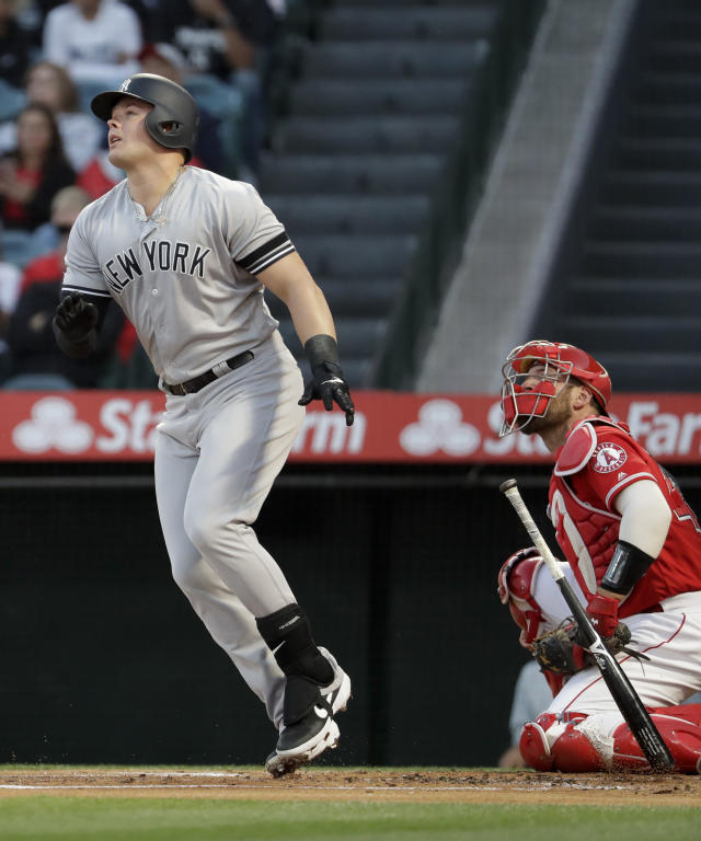 New York Yankees' Luke Voit watches his home run against the Los Angeles Angels during the first inning of a baseball game in Anaheim, Calif., Tuesday, April 23, 2019. (AP Photo/Chris Carlson)