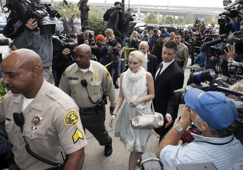 Lindsay Lohan arrives at the Los Angeles Superior Court West District Airport Courthouse Wednesday, Oct. 19, 2011, in Los Angeles. A city prosecutor will recommend Wednesday that Lohan be sent back to jail because she had been ousted from a community service assignment at a women's shelter. (AP Photo/Damian Dovarganes)