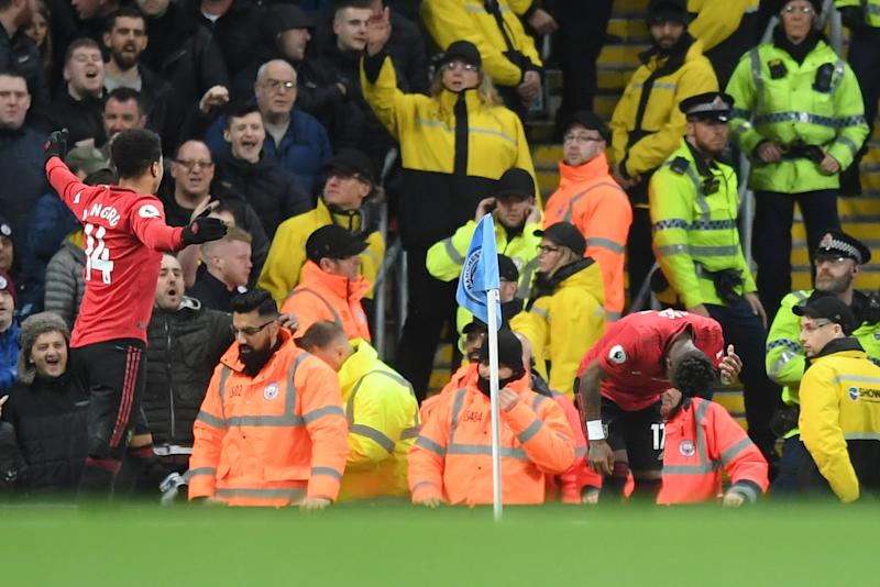 MANCHESTER, ENGLAND - DECEMBER 07: Fred of Manchester United reacts after being struck by an item thrown by the Manchester City fans during the Premier League match between Manchester City and Manchester United at Etihad Stadium on December 07, 2019 in Manchester, United Kingdom. (Photo by Michael Regan/Getty Images)