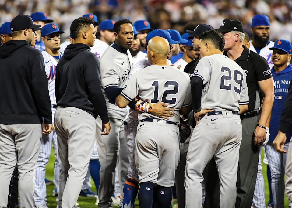 The benches clear between the Yankees and the Mets in the seventh inning at Citi Field on Sunday night.