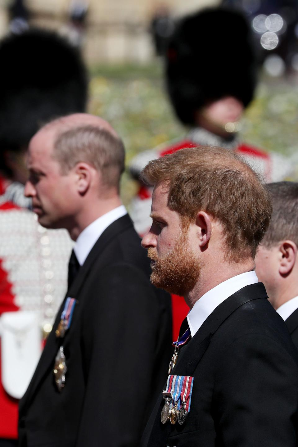 Princes William (left) and Harry walk in the procession.