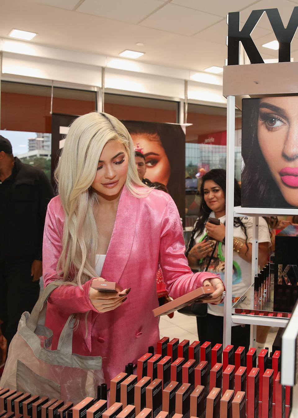 Kylie Jenner checks out her product at a beauty store. Photo: Getty