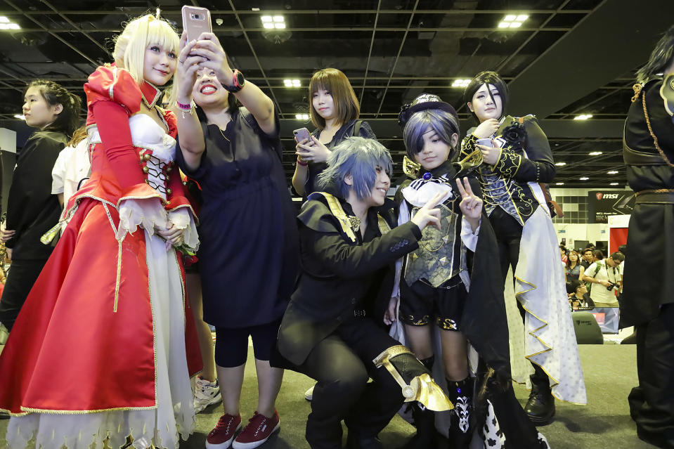 <p>Cosplayers oblige their fans with photos during a meet-and-greet session at the Asia Game Festival 2018. (PHOTO: Don Wong) </p>