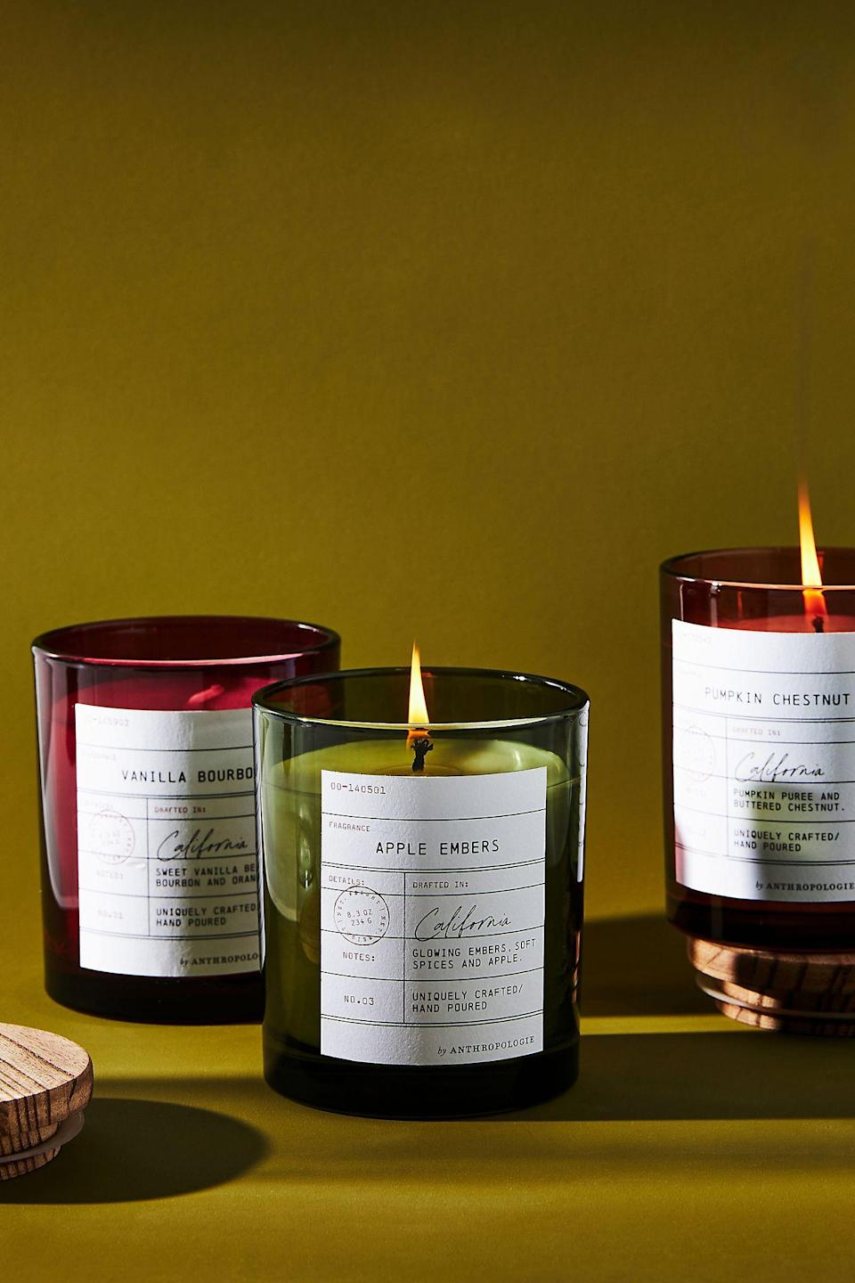 """<h3>Anthropologie Apple Embers Library Card Glass Candle</h3><br>Anthropologie is putting an academic spin on the classic fall candle — each scent (Vanilla Bourbon, Apple Embers, and Pumpkin Chestnut) comes with a library book cover card label and brings its own unique story into your living space. <br><br><em>Shop <strong><a href=""""https://www.anthropologie.com/shop/library-card-glass-candle"""" rel=""""nofollow noopener"""" target=""""_blank"""" data-ylk=""""slk:Anthropologie"""" class=""""link rapid-noclick-resp"""">Anthropologie</a></strong></em><br><br><strong>Anthropologie</strong> Library Card Glass Candle, $, available at <a href=""""https://go.skimresources.com/?id=30283X879131&url=https%3A%2F%2Fwww.anthropologie.com%2Fshop%2Flibrary-card-glass-candle"""" rel=""""nofollow noopener"""" target=""""_blank"""" data-ylk=""""slk:Anthropologie"""" class=""""link rapid-noclick-resp"""">Anthropologie</a>"""