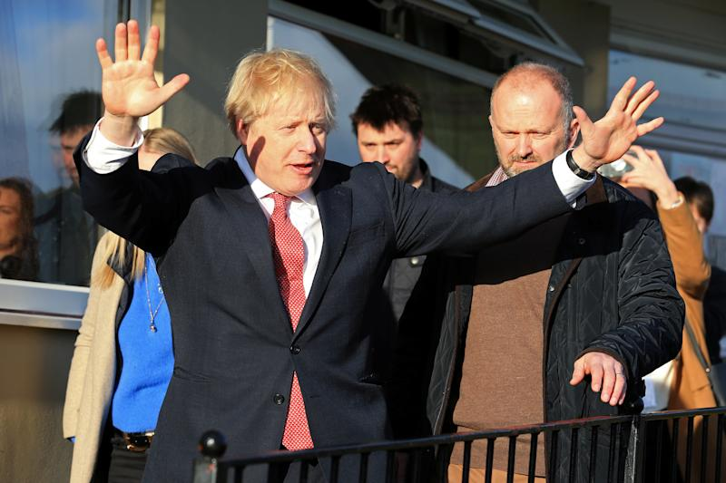 Britain's Prime Minister Boris Johnson gestures during a visit to newly elected Conservative party MP for Sedgefield, Paul Howell at Sedgefield Cricket Club in County Durham, north east England on December 14, 2019, following his Conservative party's general election victory. Lindsey Parnaby/Pool via REUTERS