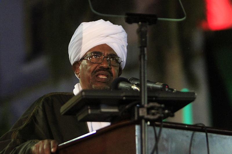Sudanese President Omar al-Bashir speaks during a celebration to mark 59 years of independence from Britain, in Khartoum on December 31, 2014
