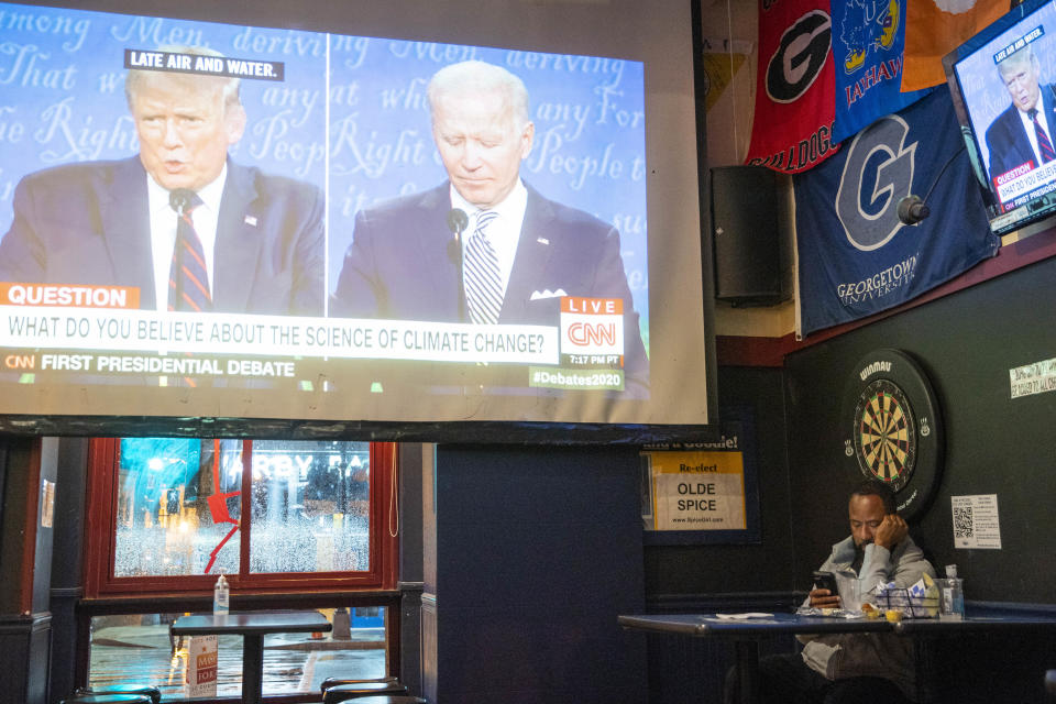 WASHINGTON, DC - SEPTEMBER 29: A man watches the first presidential debate at Nellie's Sports Bar on September 29, 2020 in Washington, United States. Americans across the country tuned in to the first presidential debate between Donald Trump and Joe Biden held in Cleveland. (Photo by Sarah Silbiger/Getty Images)