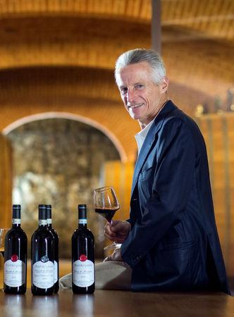 Italian businessman Riccardo Illy poses with a glass of wine in Montalcino, Italy September 29, 2016. Alexander Brookshaw/Handout via REUTERS