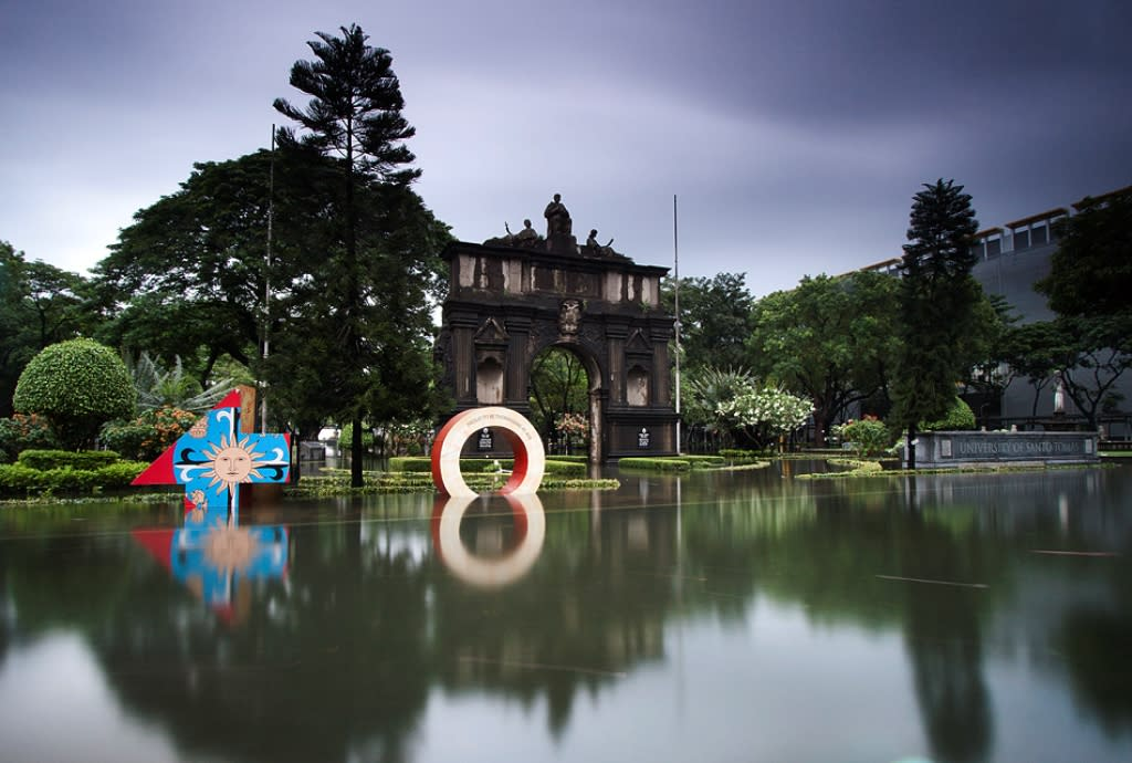 The UST Arch of the Centuries: Calm and serene in the middle of floods.  Photo by Paul Quiambao.Used with permission.