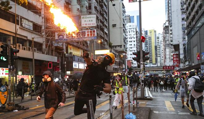 Swathes of Hong Kong have turned into fire-strewn battlegrounds in more than four months of anti-government unrest, but security chief John Lee says he is the person to lead the city's return to peace. Photo: Sam Tsang