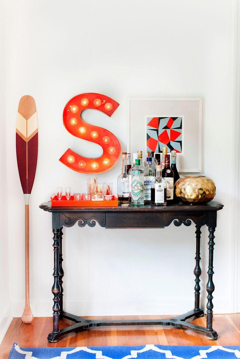 <p>Sometimes, all it takes is a personal touch to pull a room together. Take your bar cart to the next level with a retro-inspired marquee letter, colorful wall art, and a decorative oar to bring style your space.</p>