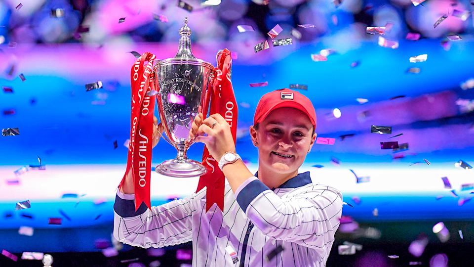 Ash Barty celebrates winning the WTA Finals title.