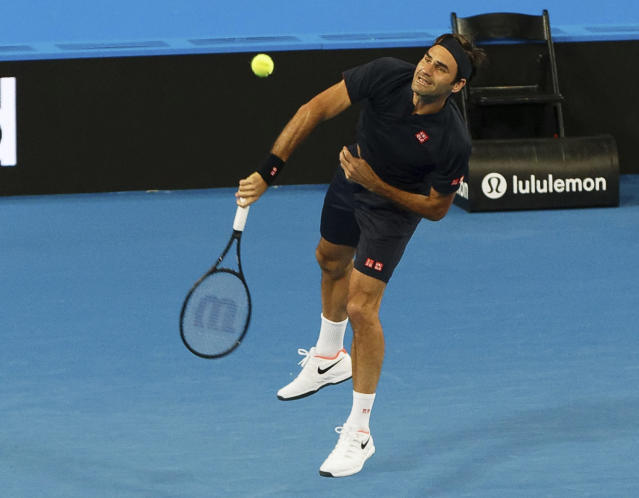 Roger Federer of Switzerland during his mixed doubles match with Belinda Bencic, against Cameron Norrie and Katie Boulter of Britain at the Hopman Cup in Perth, Australia, Sunday Dec. 30, 2018. (AP Photo/Trevor Collens)