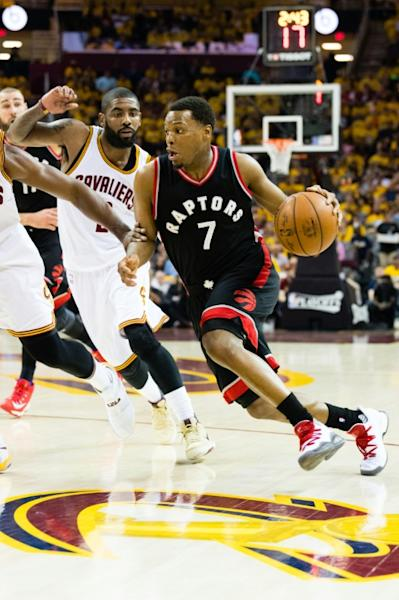 Kyle Lowry of the Toronto Raptors drives around Kyrie Irving of the Cleveland Cavaliers in Game One of the NBA Eastern Conference semi-finals, at Quicken Loans Arena in Cleveland, Ohio, on May 1, 2017