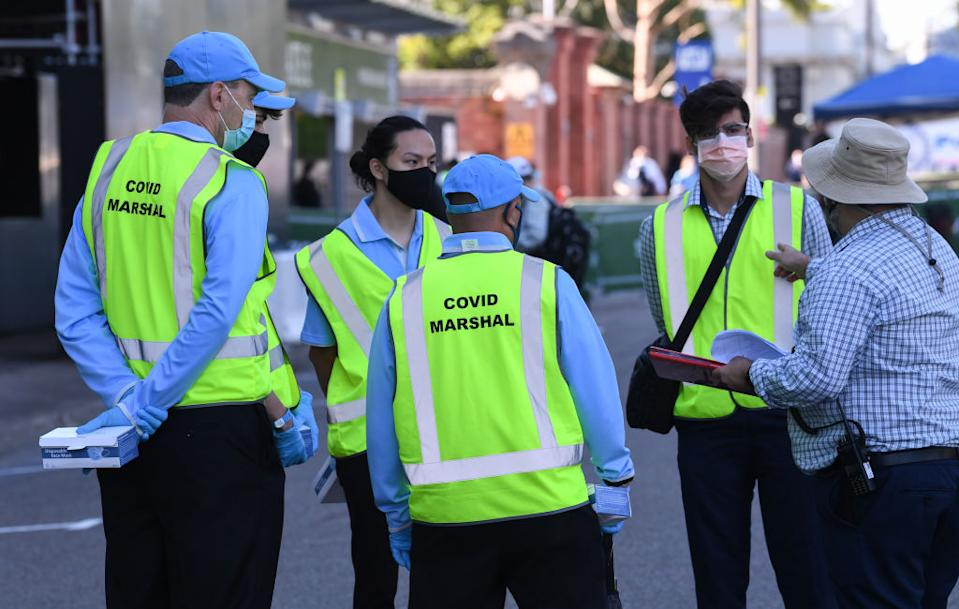Covid marshals for crowd safety outside the Sydney Cricket Ground.