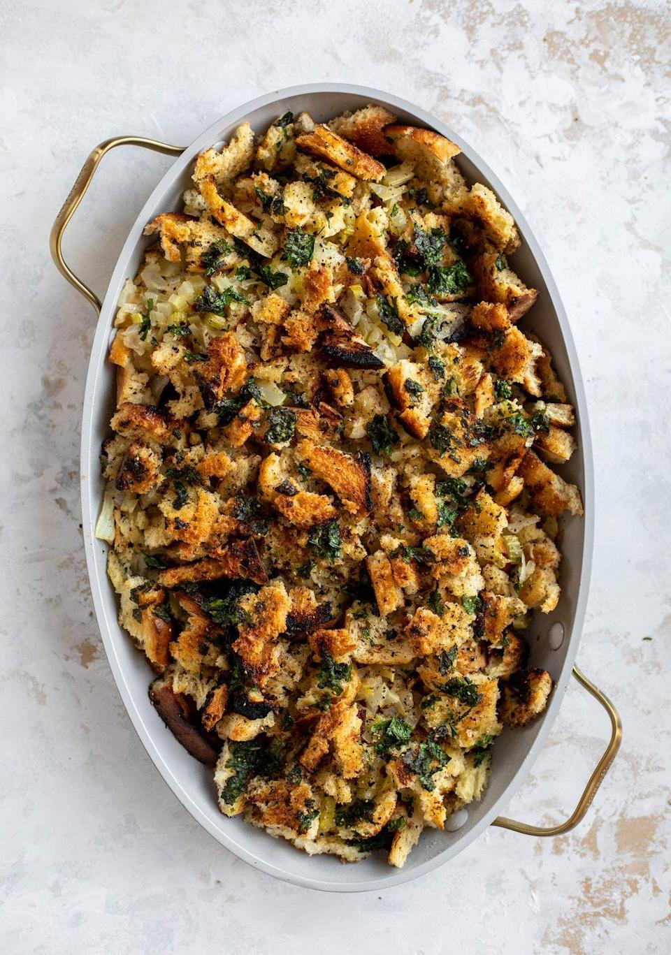 "<p>Your regular old stuffing is totally transformed by using toasty, grilled bread.</p><p><strong>Get the recipe at <a href=""https://www.howsweeteats.com/2019/11/grilled-bread-stuffing/"" rel=""nofollow noopener"" target=""_blank"" data-ylk=""slk:How Sweet Eats"" class=""link rapid-noclick-resp"">How Sweet Eats</a>.</strong></p><p><strong><a class=""link rapid-noclick-resp"" href=""https://go.redirectingat.com?id=74968X1596630&url=https%3A%2F%2Fwww.walmart.com%2Fbrowse%2Fhome%2Fserveware%2Fthe-pioneer-woman%2F4044_623679_639999_2347672%3Ffacet%3Dbrand%253AThe%2BPioneer%2BWoman&sref=https%3A%2F%2Fwww.thepioneerwoman.com%2Ffood-cooking%2Fmeals-menus%2Fg33251890%2Fbest-thanksgiving-sides%2F"" rel=""nofollow noopener"" target=""_blank"" data-ylk=""slk:SHOP SERVING UTENSILS"">SHOP SERVING UTENSILS</a><br></strong></p>"