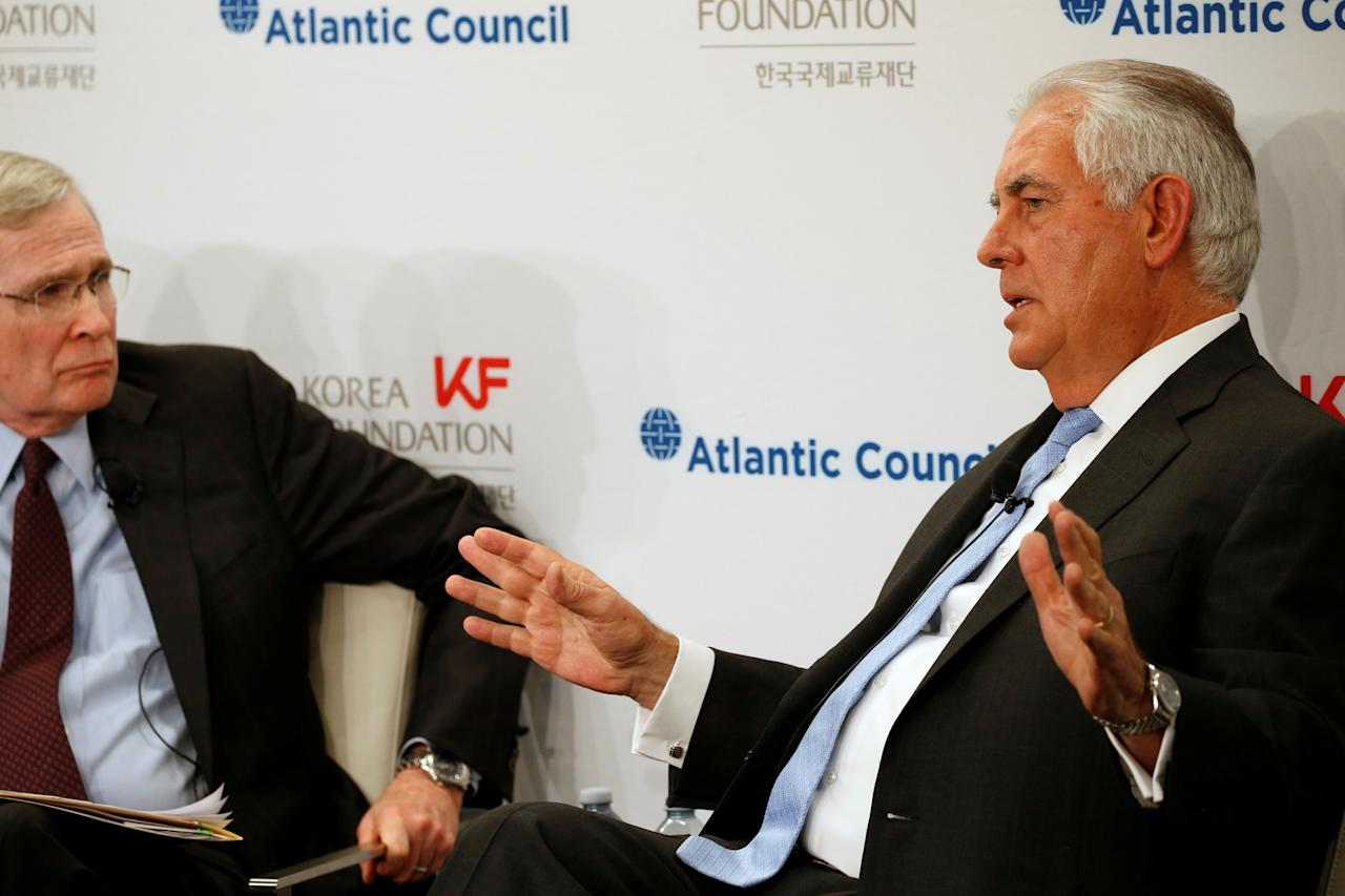 U.S. Secretary of State Rex Tillerson answers a question on the U.S.-Korea relationship from former U.S. National Security Adviser Stephen Hadley (L), during a forum at the Atlantic Council in Washington, U.S. December 12, 2017.  REUTERS/Jonathan Ernst
