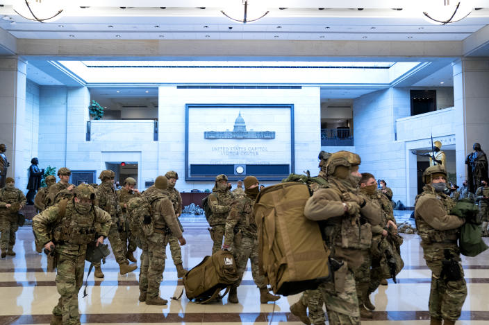 WASHINGTON, DC - JANUARY 13: Members of the National Guard move through the Visitor Center of the U.S. Capitol on January 13, 2021 in Washington, DC. Security has been increased throughout Washington following the breach of the U.S. Capitol last Wednesday, and leading up to the Presidential inauguration. (Photo by Stefani Reynolds/Getty Images)