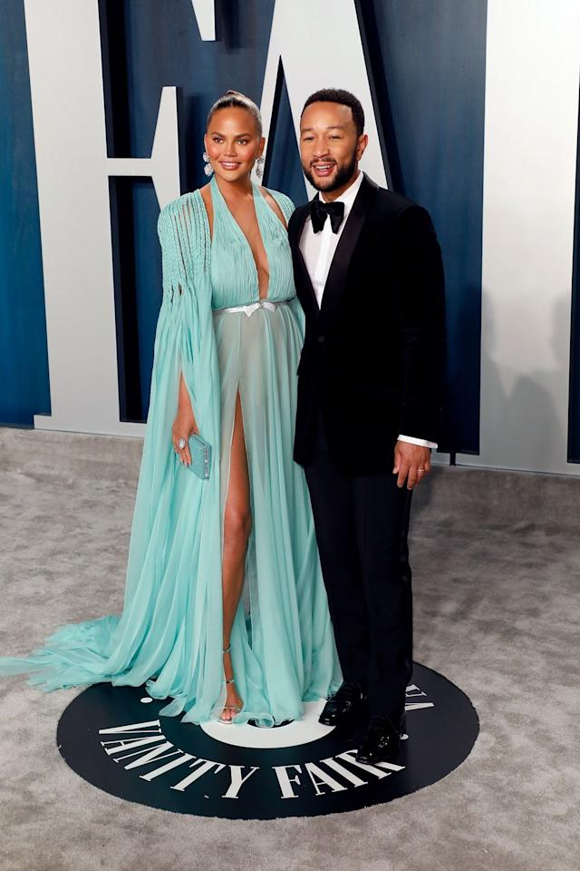 <p>Chrissy Teigen and John Legend at the Vanity Fair Oscars afterparty.</p>