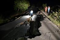 On one of the district's two main roads, AFP reporters could see cracks at least four feet (1.2 meters) deep, some filling with water from a nearby canal
