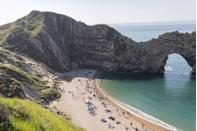 """<p>This natural limestone arch on the Jurassic Coast was used as a filming location during Game Of Thrones, and is breathtaking. Not surprisingly, it's<a href=""""https://www.redonline.co.uk/red-women/news-in-brief/a36314960/the-best-beaches-in-the-uk-in-2021/"""" rel=""""nofollow noopener"""" target=""""_blank"""" data-ylk=""""slk:also one of the best beaches in the UK."""" class=""""link rapid-noclick-resp""""> also one of the best beaches in the UK. </a></p>"""