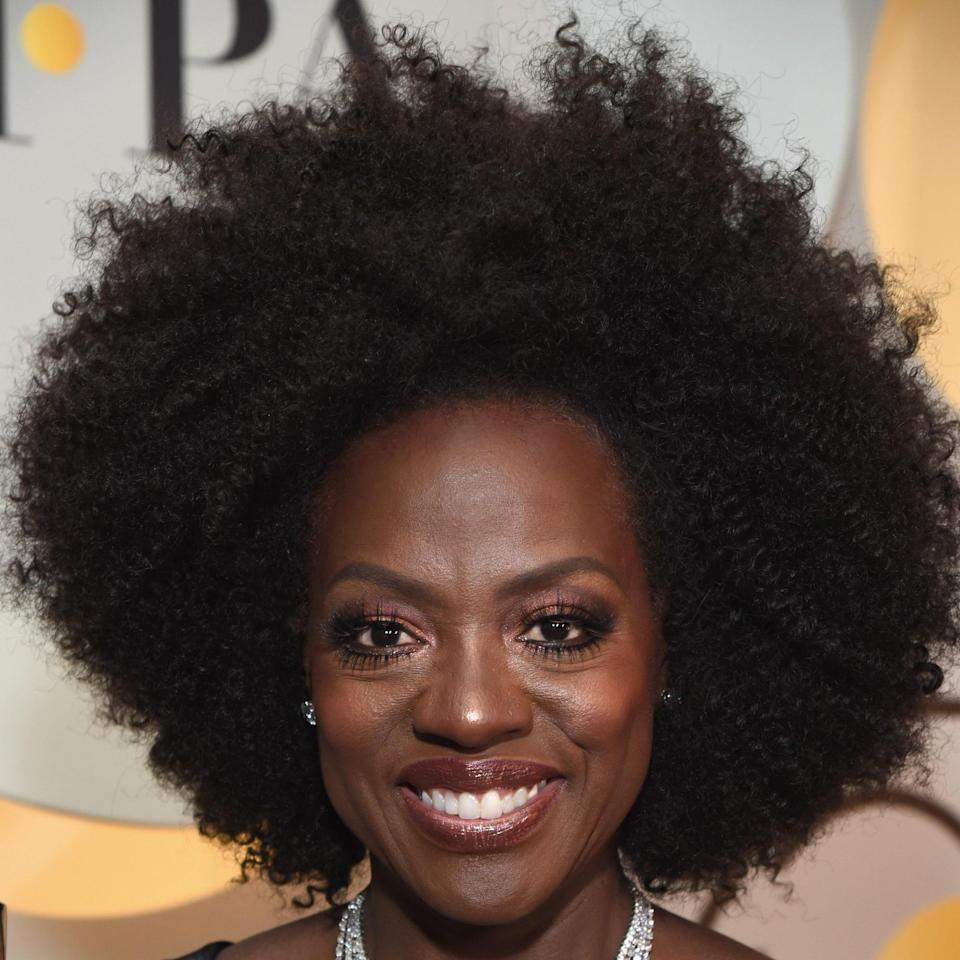"""We're simply mesmerized by the sheer volume and symmetry of Viola Davis's 'fro here. According to Amos, """"This haircut is absolutely perfect for type 4A to 4C curls. It is the texture of these curls that keep the Afro stacked and in its regal shape, without dropping or splitting at the top."""" His tip? Have your hairdresser cut your hair tapered at the neck, widening at the ears, and up to its highest point in the middle of the forehead."""