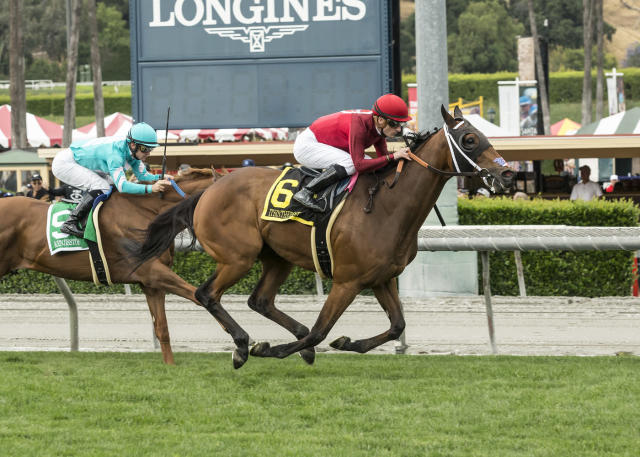 In this image provided by Benoit Photo, Itsinthepost, right, with Julien Leparoux aboard, outlegs Kenjisstorm, left, with Flavien Prat aboard, to win the Grade II $200,000 Charles Whittingham Stakes horse race Saturday, May 26, 2018, at Santa Anita in Arcadia, Calif. (Benoit Photo via AP)