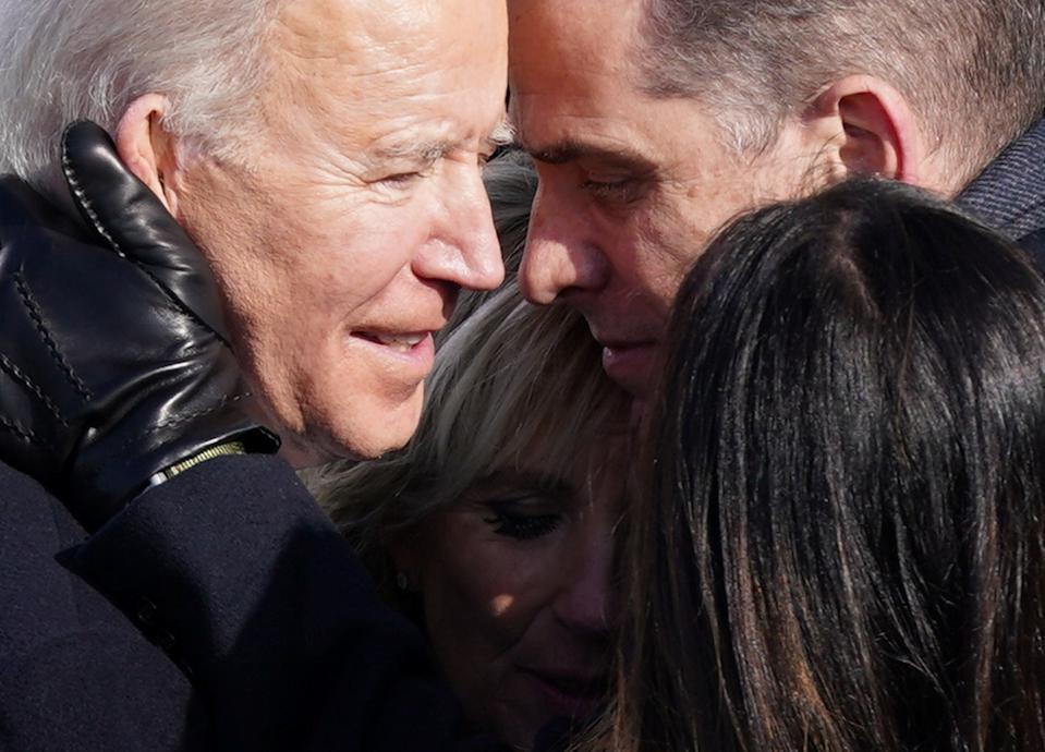 U.S. President Joe Biden embraces his family after he was sworn in as the 46th President of the United States. (Kevin Lamarque/Reuters)