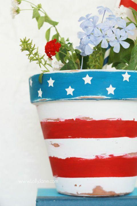 """<p>This easy-to-make stars-and-stripes flower pot can stay on your patio all summer long. </p><p><em><strong>Get the tutorial from <a href=""""http://lollyjane.com/stars-stripes-patriotic-flower-pot/"""" rel=""""nofollow noopener"""" target=""""_blank"""" data-ylk=""""slk:Lolly Jane"""" class=""""link rapid-noclick-resp"""">Lolly Jane</a>.</strong></em> </p>"""