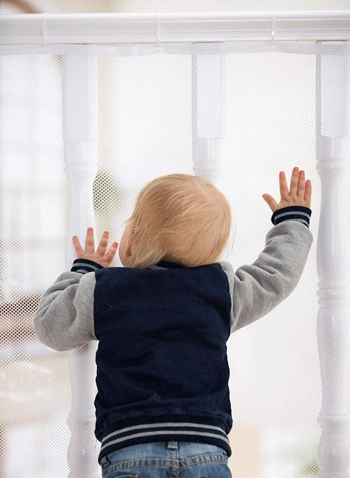 """It'ssure to help you breathe easy if your baby's first steps are the first time you realize you have to cover up your bannisters.<br /><br /><strong>Promising review:</strong>""""I can't say enough great things about this product. After I ordered it they sent me an e-mail with an illustrated installation guide with tips, VERY HELPFUL.<strong>I LOVE that the zip-ties are adjustable</strong>! I had to readjust them several times to get it looking great (I'm a perfectionist) It was easy to install and a great comfort to have it set up knowing that my little one will be safe. We have a split level and this works great!"""" — <a href=""""https://www.amazon.com/gp/customer-reviews/RG71R2X5522XS?&linkCode=ll2&tag=huffpost-bfsyndication-20&linkId=8c70a9993bd9657470e3612be4eec154&language=en_US&ref_=as_li_ss_tl"""" target=""""_blank"""" rel=""""noopener noreferrer"""">Andrea Miller</a><br /><br /><strong><a href=""""https://www.amazon.com/dp/B01AER7I7G?&linkCode=ll1&tag=huffpost-bfsyndication-20&linkId=bdc0bde384558c07f52e12b262918055&language=en_US&ref_=as_li_ss_tl"""" target=""""_blank"""" rel=""""noopener noreferrer"""">Get it from Amazon for $19.99 (available in two colors and two sizes).</a></strong>"""