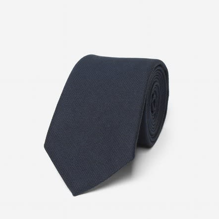 "<p>Slim, but not too skinny, this tie will never go out of style. <a href=""https://www.everlane.com/collections/the-slim-tie/products/mens-texture-tie-navy"" rel=""nofollow noopener"" target=""_blank"" data-ylk=""slk:Everlane Texture Tie"" class=""link rapid-noclick-resp"">Everlane Texture Tie </a>($55)</p>"