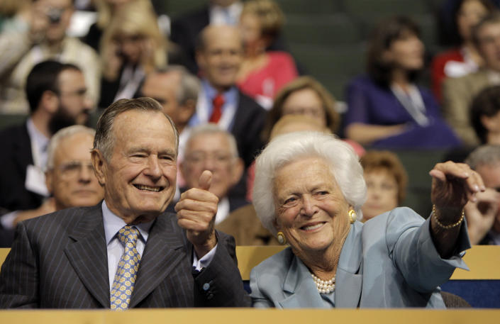 <p>Former President George H.W. Bush and his wife, Barbara, wave to friends in the crowd during the Republican National Convention in St. Paul, Minn., on Sept. 2, 2008. (Photo: Jae C. Hong/AP) </p>
