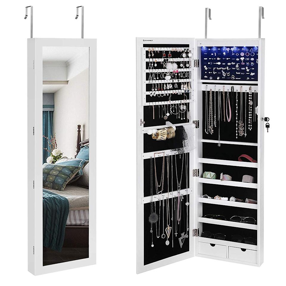"<p>Functionality meets ultimate jewelry storage with the <a href=""https://www.popsugar.com/buy/Songmics-Mirror-Jewelry-Cabinet-410874?p_name=Songmics%20Mirror%20Jewelry%20Cabinet&retailer=amazon.com&pid=410874&price=130&evar1=casa%3Aus&evar9=45752594&evar98=https%3A%2F%2Fwww.popsugar.com%2Fhome%2Fphoto-gallery%2F45752594%2Fimage%2F45753851%2FThose-Who-Love-Accessorize&list1=amazon%2Caccessories%2Corganization%2Cstorage%20tips%2Chome%20organization&prop13=mobile&pdata=1"" class=""link rapid-noclick-resp"" rel=""nofollow noopener"" target=""_blank"" data-ylk=""slk:Songmics Mirror Jewelry Cabinet"">Songmics Mirror Jewelry Cabinet</a> ($130). Not only is it an over-the-door (or mounted - your choice) mirror, but it opens to feature double-sided jewelry storage with built-in LED lights. Fancy!</p>"