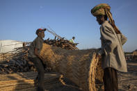 Tigray men who fled the conflict in Ethiopia's Tigray region, work to build shelters at Umm Rakouba refugee camp in Qadarif, eastern Sudan, Thursday, Nov. 26, 2020. Ethiopia's prime minister said Thursday the army has been ordered to move on the embattled Tigray regional capital after his 72-hour ultimatum ended for Tigray leaders to surrender, and he warned the city's half-million residents to stay indoors and disarm. (AP Photo/Nariman El-Mofty)
