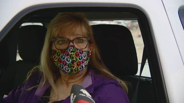 """Barb Nicholson said she is """"extremely grateful"""" to get a COVID-19 vaccine, but she said she would have given up her spot in line so a police officer could get the shot."""