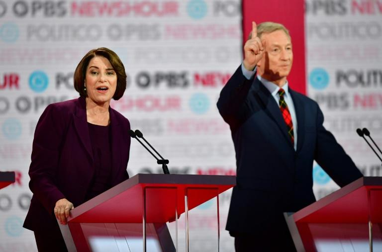 US Senator Amy Klobuchar, seen here on stage with activist Tom Steyer, at the final Democratic presidential debate of 2019, gave what several experts described as her best debate performance of the 2020 race (AFP Photo/Frederic J. BROWN)