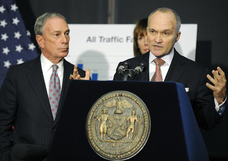 """FILE - In this Dec. 29, 2011, file photo, New York City Police Commissioner Ray Kelly speaks at a news conference with New York Mayor Michael Bloomberg, left,   in Brooklyn, N.Y.  New York Police Department spying operations began after the 2001 terror attacks with unusual help from a CIA officer. """"If there are threats or leads to follow, then the NYPD's job is to do it,"""" Bloomberg said. """"The law is pretty clear about what's the requirement, and I think they follow the law. We don't stop to think about the religion. We stop to think about the threats and focus our efforts there."""" (AP Photo/Henny Ray Abrams, File)"""