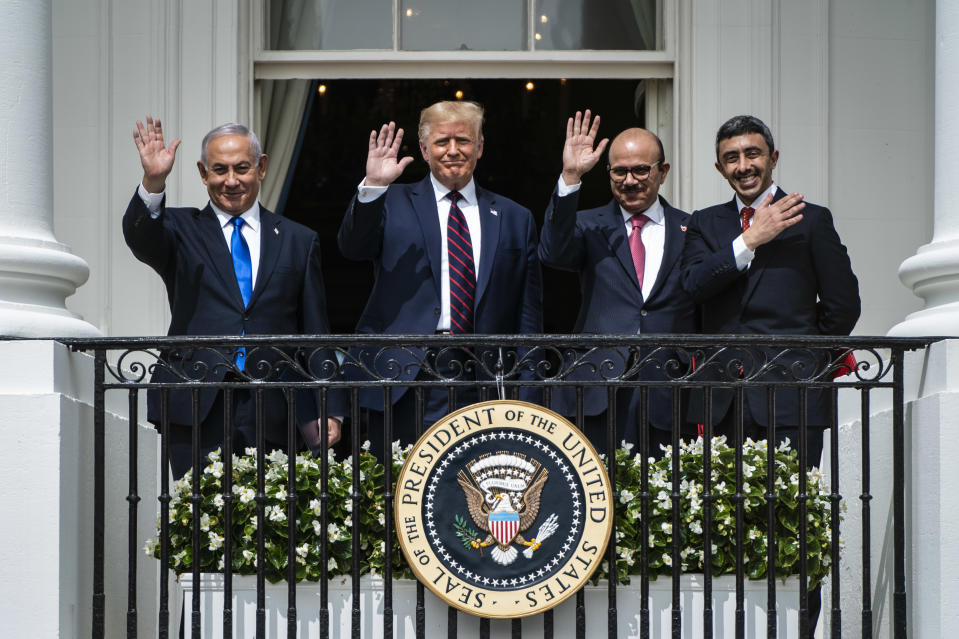 Israeli Prime Minister Benjamin Netanyahu, President Trump, Bahrain Foreign Minister Khalid bin Ahmed Al Khalifa and United Arab Emirates Foreign Minister Abdullah bin Zayed Al-Nahyan wave from a balcony at the White House