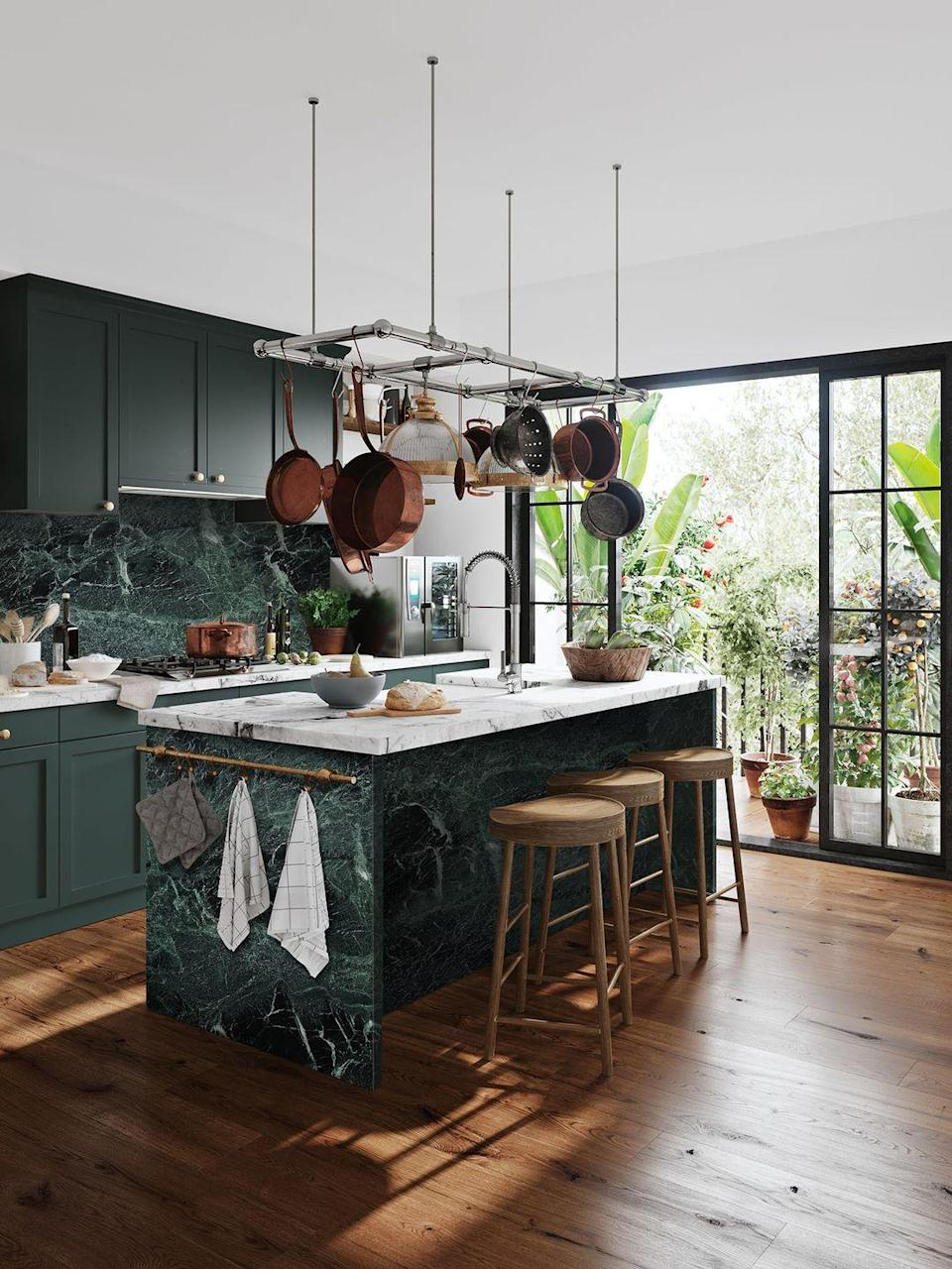 "<p>At the start of 2020, the staple kitchen island was slowly adapting into the dining island, ensuring the family can cook, dine and spend time together in one room. For 2021, the desire for a kitchen island remains strong. According to Homebase, nearly 85 per cent of customers surveyed prefer an island in their kitchen.</p><p>'Kitchen islands are a perennial favourite but are even more in demand as we demand more and more of our kitchens as workspaces, classrooms and food preparation areas,' says Tom Howley, Creative Director at <a href=""https://www.tomhowley.co.uk/"" rel=""nofollow noopener"" target=""_blank"" data-ylk=""slk:Tom Howley"" class=""link rapid-noclick-resp"">Tom Howley</a>. 'I have designed kitchens where the island counter makes up just 15 per cent of the worktop space but boasts 90 per cent usage. When possible, do fit an island counter. They serve as impromptu dinner tables, bars, home offices and food prep stations. Sometimes all at the same time.'<br></p><p>Pictured: Verde Tinos Marble in green, <a href=""https://geraldculliford.co.uk/product/verde-tinos/"" rel=""nofollow noopener"" target=""_blank"" data-ylk=""slk:Cullifords"" class=""link rapid-noclick-resp"">Cullifords</a></p>"