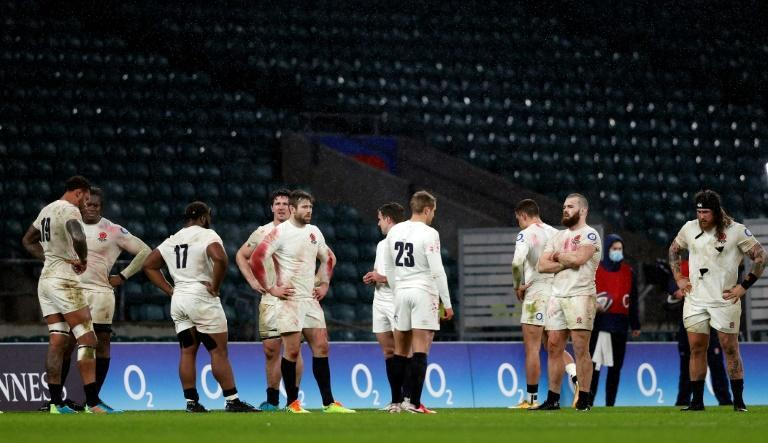 Defeated men: England players stand dejected