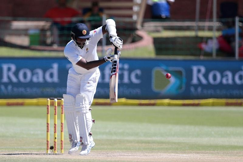Sri Lanka batsman and Captain Angelo Mathews plays a shot on the fifth and last day of their first Test match against South Africa, in Port Elizabeth, on December 30, 2016