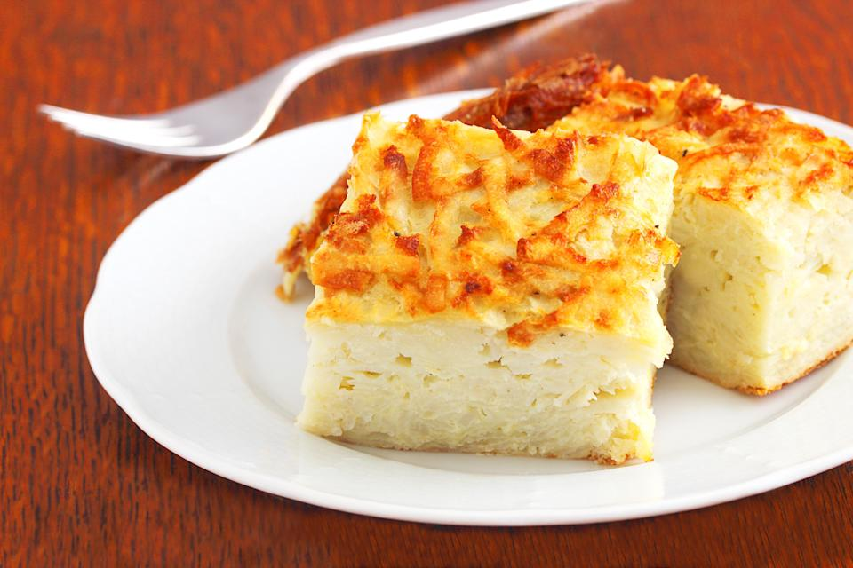 """<p>The crispy outside and creamy inside of an expertly made potato kugel is a thing of beauty. Somewhere between a thick latke and a Spanish tortilla, this simple and satisfying traditional dish is one of <a href=""""https://www.thedailymeal.com/cook/50-great-ways-cook-potatoes-0?referrer=yahoo&category=beauty_food&include_utm=1&utm_medium=referral&utm_source=yahoo&utm_campaign=feed"""" rel=""""nofollow noopener"""" target=""""_blank"""" data-ylk=""""slk:the all-time best potato recipes"""" class=""""link rapid-noclick-resp"""">the all-time best potato recipes</a>. If you prefer a sweet twist, then try out this <a href=""""https://www.thedailymeal.com/recipes/shredded-apple-kugel-recipe?referrer=yahoo&category=beauty_food&include_utm=1&utm_medium=referral&utm_source=yahoo&utm_campaign=feed"""" rel=""""nofollow noopener"""" target=""""_blank"""" data-ylk=""""slk:shredded apple kugel recipe"""" class=""""link rapid-noclick-resp"""">shredded apple kugel recipe</a>.</p> <p><a href=""""https://www.thedailymeal.com/recipes/classic-potato-kugel-recipe?referrer=yahoo&category=beauty_food&include_utm=1&utm_medium=referral&utm_source=yahoo&utm_campaign=feed"""" rel=""""nofollow noopener"""" target=""""_blank"""" data-ylk=""""slk:For the Classic Potato Kugel recipe, click here."""" class=""""link rapid-noclick-resp"""">For the Classic Potato Kugel recipe, click here.</a></p>"""