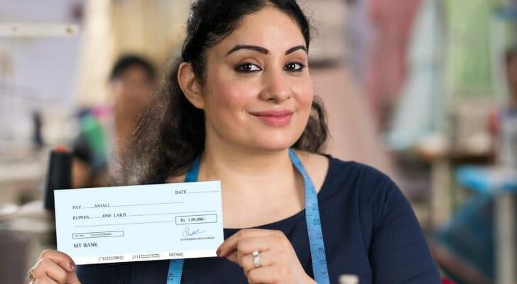 Woman with a dividend check