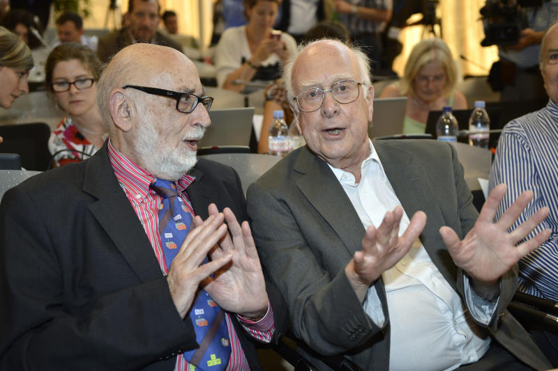 FILE - In this Wednesday, July 4, 2012, file photo, Belgian physicist Francois Englert, left, and British physicist Peter Higgs answer a journalist's question about the Higgs boson at the European Organization for Nuclear Research (CERN) in Meyrin, near Geneva. Englert and Higgs were awarded the Nobel physics prize on Tuesday, Oct. 8, 2013. (AP Photo/Keystone, Martial Trezzini, File)
